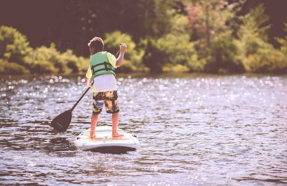 Young Boy Stand Up Paddleboarding