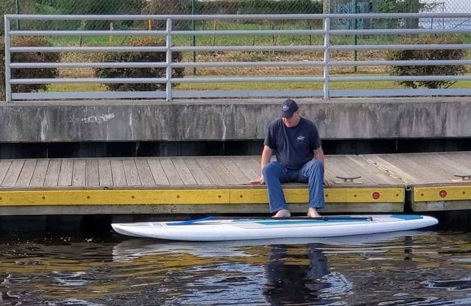 Man Getting on a Stand Up Paddleboard