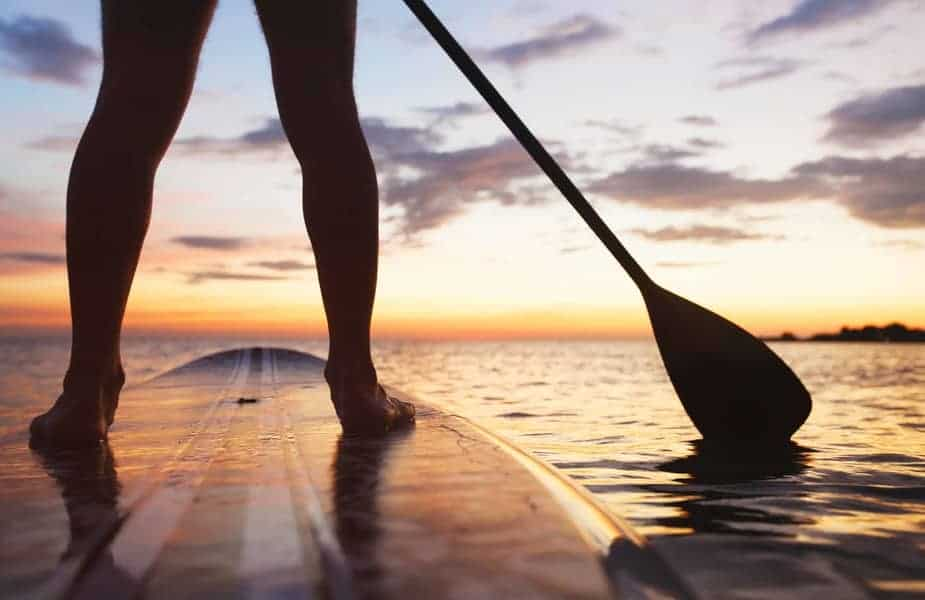 Picture of Back of Legs on a Stand Up Paddleboard at Sunset