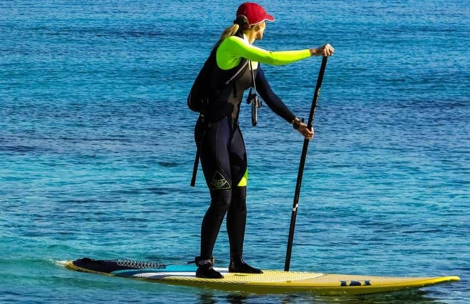 Stand Up Paddleboarder Wearing Shoes